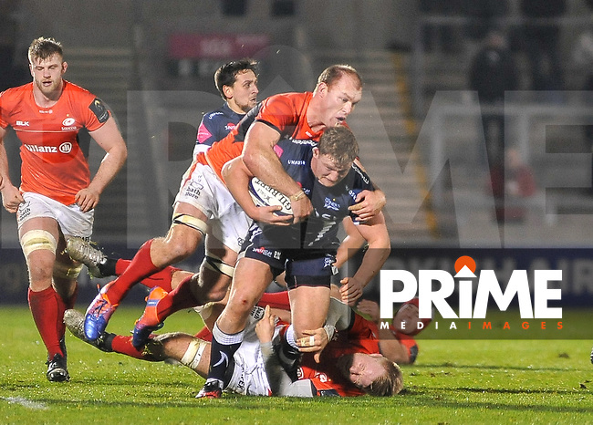 Sale Sharks Ross Harrison tackled by saracens No 5 George Kruis during the European Rugby Champions Cup match between Sale Sharks and Saracens at AJ Bell Stadium, Salford, England on 18 December 2016. Photo by Paul Bell.