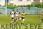 Stacks Greg Horan about to deliver a long range effort despite the attentions of Brian Fitzgerald and Bryan O'Shea of Dr Crokes in the Div 1 of the County football league in Connolly Park on Sunday.