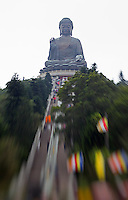 The Tian Tan Buddha, made of bronze, sits on Lantau Island in Hong Kong.  Photographed with a tilt-shift lens.