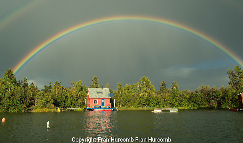 Houseboat under rainbow