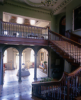 An impressive wooden staircase sweeps down into the double-height Palladian entrance hall which has a painted ceiling by William Kent