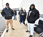 At 2:30 pm only these five shoppers were standing in line outside the Best Buy store in Fairview Heights. All of them were there to buy heavily-discounted big screen televisions. From left: Steven Smith from Centralia, Anthony Click from Granite City, Jesus Carmona and his wife Maria Carmona, both of Collinsville, and Brandon Stewart from O'Fallon, Illinois. The store wasn't opening until 5 pm. Stewart - who was first in line - got there a little before 11 am. Shoppers looking for bargains and discounted items endured a light but steady rain on Thanksgiving Day as they waited for stores to open in Fairview Heights, IL on November 28, 2019.<br />  Photo by Tim Vizer