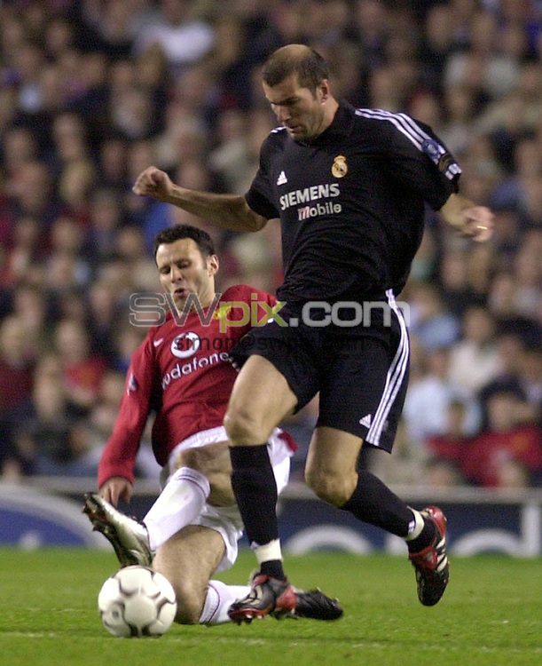 Pix: Matthew Lewis/SWpix.com. Soccer. UEFA Champions League, Quarter-Final 2nd leg. Manchester UNited v Real Madrid. 23/04/03..COPYRIGHT PICTURE>>SIMON WILKINSON>>01943 436649>>..Manchester's Ryan Giggs tackles Real's Zinedin Zidane.