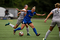 Seattle, WA - Sunday August 13, 2017: Ashley Hatch, Merritt Mathias during a regular season National Women's Soccer League (NWSL) match between the Seattle Reign FC and the North Carolina Courage at Memorial Stadium.