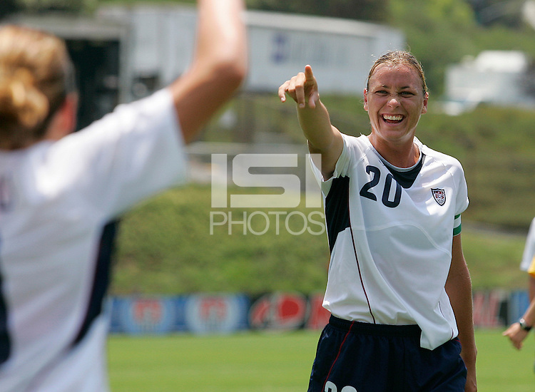 USA's Abby Wambach, right, congratulates Cat Whitehill, left, during a 5-0 victory over Ireland in San Diego, California, Sunday, July 23, 2006.