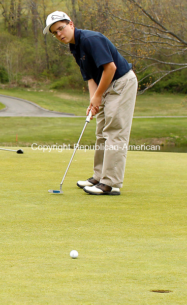 Goshen, CT-26 April 2012-042612CM01- Kennedy's Joseph DeMichele puts for the cup on the 2nd green at the Torrington Country Club Thursday afternoon in Goshen.  Torrington defeated Kennedy, 169-236. DeMichele shot a 50.   Christopher Massa Republican-American