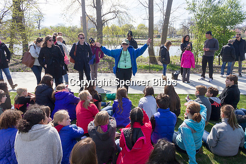 Saturday, April 22nd, 2017 was Earth Day and the Jackson Park Advisory Council stepped up with various projects around the neighborhood.<br /> <br /> 2714, 2721 &ndash; President of the Jackson Park Advisory Council, Louise Mcurry explains the history of the Japanese Garden to members of the Chicago Children&rsquo;s Choir.<br /> <br /> Please 'Like' &quot;Spencer Bibbs Photography&quot; on Facebook.<br /> <br /> All rights to this photo are owned by Spencer Bibbs of Spencer Bibbs Photography and may only be used in any way shape or form, whole or in part with written permission by the owner of the photo, Spencer Bibbs.<br /> <br /> For all of your photography needs, please contact Spencer Bibbs at 773-895-4744. I can also be reached in the following ways:<br /> <br /> Website &ndash; www.spbdigitalconcepts.photoshelter.com<br /> <br /> Text - Text &ldquo;Spencer Bibbs&rdquo; to 72727<br /> <br /> Email &ndash; spencerbibbsphotography@yahoo.com