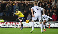 Kemar Roofe of Oxford United fires a shot at goal during the Johnstone's Paint Trophy Southern Final 2nd Leg match between Oxford United and Millwall at the Kassam Stadium, Oxford, England on 2 February 2016. Photo by Andy Rowland / PRiME Media Images.