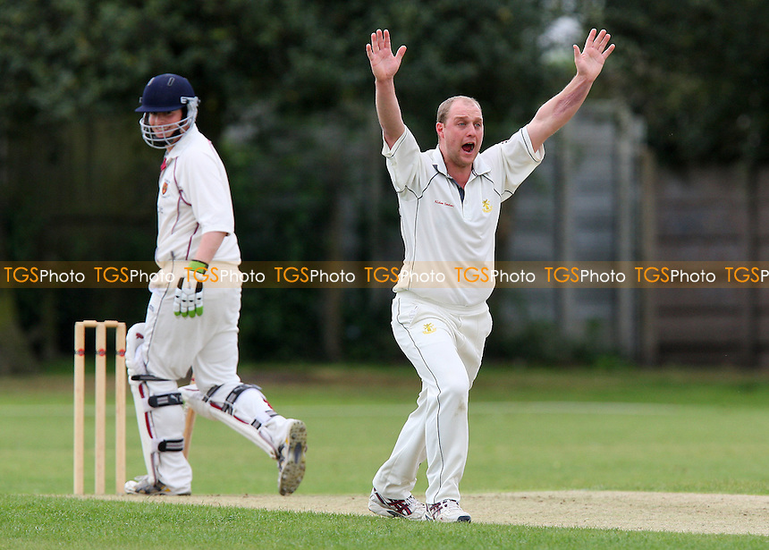 T Wyatt of Upminster appeals for the wicket of Colchester batsman N O'Brien (R) - Upminster CC vs Colchester & East Essex CC - Essex Cricket League at Upminster Park - 16/05/09 - MANDATORY CREDIT: Gavin Ellis/TGSPHOTO - Self billing applies where appropriate - 0845 094 6026 - contact@tgsphoto.co.uk - NO UNPAID USE.
