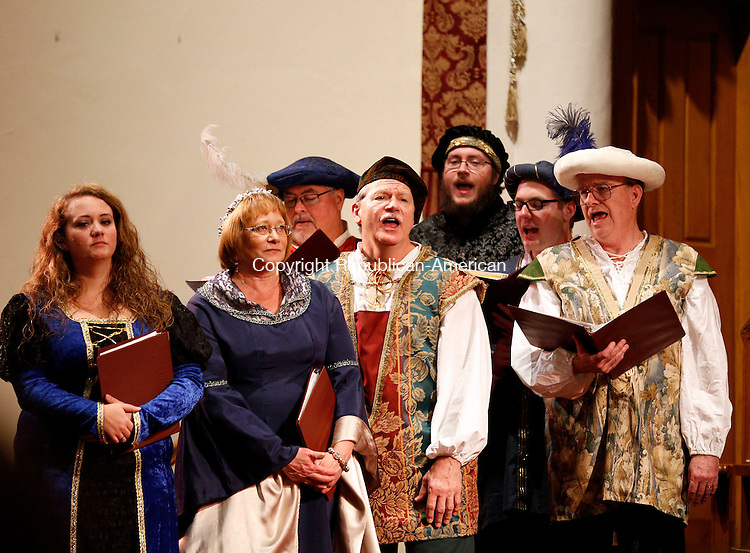 """Winsted, CT- 09 January 2016-010916CM08-  Performers entertain a crowd by singing """"Soul Cake"""" during the First Church of Winsted's 26th annual Boar's Head Festival in Winsted on Saturday. The Medieval celebration of the Epiphany, featured period costumes, live animals, the Laurel City Singers choir, a brass ensemble, pipers, dancers and drummers.  An additional seating of the festival will be held on Sunday at 3:30 p.m. with doors opening and pre-show performances one half-hour before the show time. Tickets are $9 for children 12 and under, $12 for seniors and $15 for adults.  Proceeds will benefit the Sharon Lewis Memorial Scholarship Fund and the Open Door Soup Kitchen.  Christopher Massa Republican-American"""