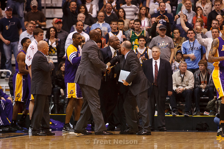 Trent Nelson  |  The Salt Lake Tribune.Los Angeles coach Mike Brown is restrained after being ejected from the game in the fourth quarter as the Utah Jazz host the Los Angeles Lakers, NBA basketball Saturday, February 4, 2012 at EnergySolutions Arena in Salt Lake City, Utah.