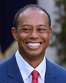 "Professional golfer Tiger Woods listens as United States President Donald J. Trump makes remarks presenting him the Presidential Medal of Freedom during a ceremony in the Rose Garden of the White House in Washington, DC on May 6, 2019.  The Presidential Medal of Freedom is an award bestowed by the President of the United States to recognize those people who have made ""an especially meritorious contribution to the security or national interests of the United States, world peace, cultural or other significant public or private endeavor.""<br /> Credit: Ron Sachs / CNP"