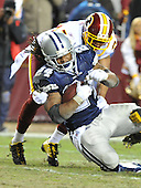 Landover, MD - December 27, 2009 -- Dallas Cowboys running back Marion Barber (24) is tackled in fourth quarter action against the Washington Redskins at FedEx Field in Landover, Maryland on Sunday, December 27, 2009.  The Cowboys won the game 17 - 0..Credit: Ron Sachs / CNP.(RESTRICTION: NO New York or New Jersey Newspapers or newspapers within a 75 mile radius of New York City)