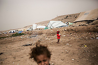 Thursday 16 July, 2015: Displaced children from the heavy fighting and bombarments in Sa'dah governorate and Haradh bordertown are seen in a temporary settlement in the outskirts of Khamer city in the Amran province of Yemen. (Photo/Narciso Contreras)