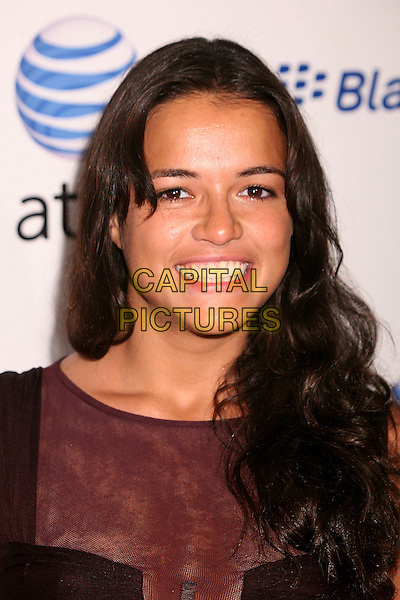 MICHELLE RODRIGUEZ.AT&T's BlackBerry Curve Launch Party at the Beverly Wilshire Hotel, Beverly Hills, California, USA,.31 May 2007..portrait headshot smiling.CAP/ADM/BP.©Byron Purvis/AdMedia/Capital Pictures.
