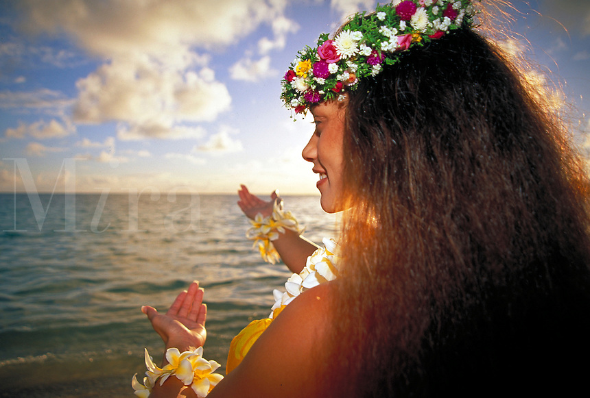 Hawaiian Hula Dancer at Sunrise. back profile, flower hair wreath, woman, women, female. Celeste Kalama. Hawaii.
