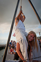 Kaylin gives a helping hand to street performer at Mallory Square, Key West, Florida, USA. Photo by Debi PIttman Wilkey