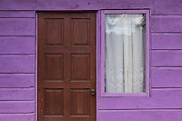 Clorful purple facade of a typical Jamaican home, Jamaica.