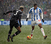 17th March 2018, The John Smiths Stadium, Huddersfield, England; EPL Premier League football, Huddersfield Town versus Crystal Palace; Collin Quaner of Huddersfield Town takes on Patrick van Aanholt of Crystal Palace in the driving snow