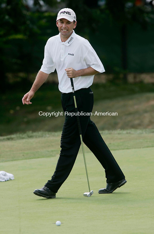 CROMWELL, CT 27 AUGUST 2005 082705BZ05- Kevin Sutherland reacts after missing the par putt  on #8<br /> during the third round of the Buick Championship at the TPC at River Highlands Saturday.<br /> Jamison C. Bazinet / Republican-American