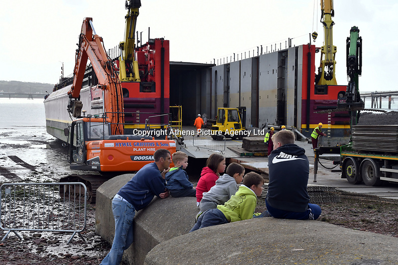 Pictured: 200 ton column being loaded onto barge at Gelliswick Bay, Wales, UK<br />
