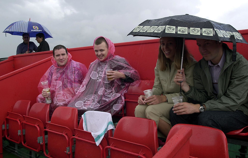 Photo:Ken Brown .11/06/2001. .Stella Artois Championship 2001 .Semi Final Day.The great british public haveing a pint while they wait for play to start in the rain