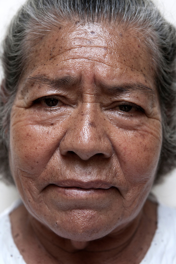 Portrait of a resident of Casa Xochiquetzal, at the shelter in Mexico City on March 14, 2008. Casa Xochiquetzal is a shelter for elderly sex workers in Mexico City. It gives the women refuge, food, health services, a space to learn about their human rights and courses to help them rediscover their self-confidence and deal with traumatic aspects of their lives. Casa Xochiquetzal provides a space to age with dignity for a group of vulnerable women who are often invisible to society at large. It is the only such shelter existing in Latin America. Photo by Bénédicte Desrus