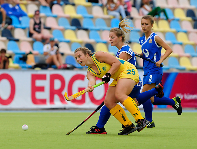 MOENCHENGLADBACH, GERMANY - JULY 28: Match between Australia (yellow) and Russia (blue) in Pool C during the Hockey Junior World Cup at the Warsteiner HockeyPark on July 28, 2013 in Moenchengladbach, Germany. Final score 6-0. (Photo by Dirk Markgraf/www.265-images.com) *** Local caption *** #25 Jade Warrender of Australia