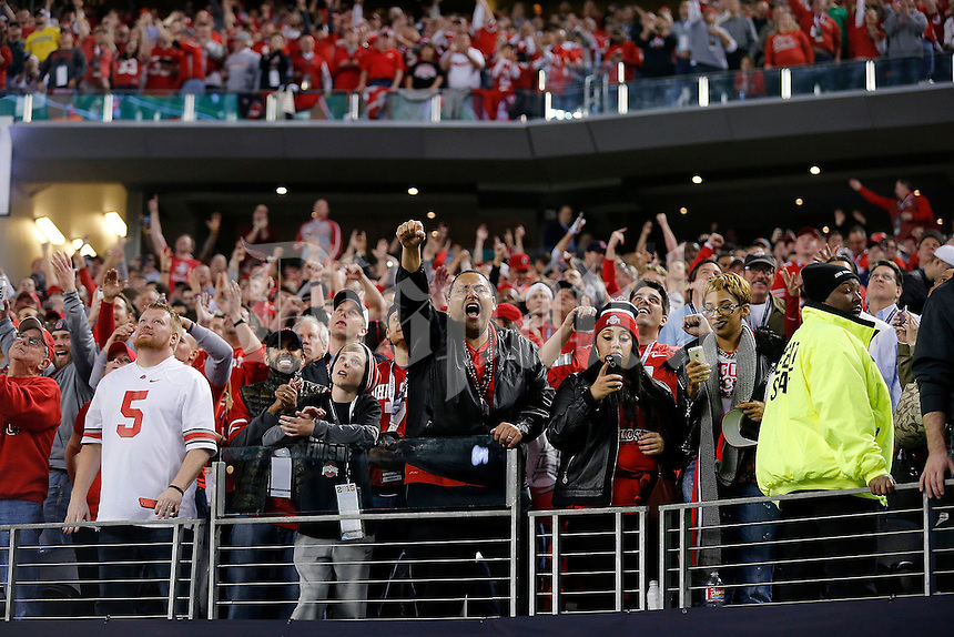 Fans celebrate near the end of the College Football Playoff National Championship at AT&T Stadium in Arlington, TX on Monday, January 12, 2015. (Columbus Dispatch photo by Jonathan Quilter)