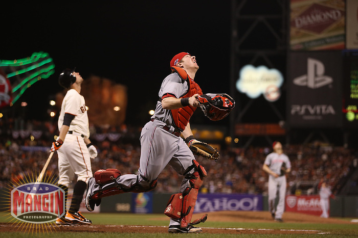 SAN FRANCISCO - OCTOBER 7:  Ryan Hanigan of the Cincinnati Reds chases a pop up during Game 2 of the NLDS against the San Francisco Giants at AT&T Park on October 7, 2012 in San Francisco, California. (Photo by Brad Mangin)