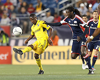 Columbus Crew midfielder Kevan George (37) passes the ball as New England Revolution midfielder Shalrie Joseph (21) defends. In a Major League Soccer (MLS) match, the New England Revolution tied the Columbus Crew, 0-0, at Gillette Stadium on June 16, 2012.