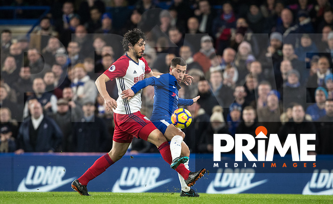 Eden Hazard of Chelsea & Ahmed Hegazy of WBA during the Premier League match between Chelsea and West Bromwich Albion at Stamford Bridge, London, England on 12 February 2018. Photo by Andy Rowland.