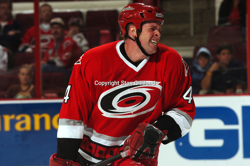 Carolina Hurricanes' defenseman Aaron Ward grimaces in pain after taking a shot to the foot during a game with the Tampa Bay Lightning Thursday, Sep. 22, 2005 in Raleigh, NC. Carolina won 5-2.
