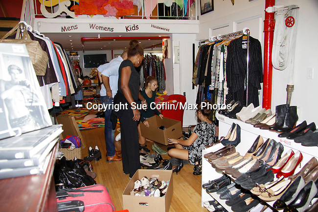 September 20, 2015 reorganizing the store -The Thrifty HoG is an upscale resale boutique with a selection of chic new very gently used and vintage clothing for men, women and children, home decor items and small furnishings. The proceeds benefit homeless mothers and children and also provides job-training for these struggling women. The Goal at Hearts of Gold is simple: Empowerment, sustainability, self-sufficiency and Lots of Love. The Thrift HoG is located at 11 W. 25th Street, New York City, New York.  (Photo by Sue Coflin/Max Photos)