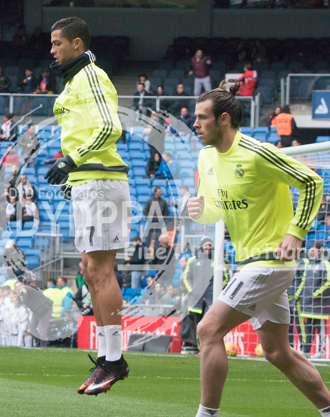 Real Madrid's Portuguese forward Cristiano Ronaldo and Real Madrid's Welsh forward Gareth Bale warming