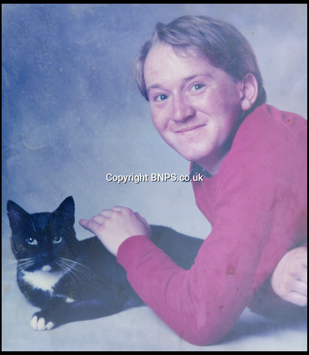 BNPS.co.uk (01202) 558833<br /> Picture: Collect/BNPS<br /> <br /> Andrew Young pictured with cat Bobby.<br /> <br /> Andrew Young, 40, became embroiled in an argument with Victor Ibitoye after he blasted him for riding his bike on the pavement.