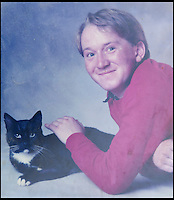 BNPS.co.uk (01202) 558833<br /> Picture: Collect/BNPS<br /> <br /> Andrew Young pictured with cat Bobby.<br /> <br /> Andrew Young, 40, became embroiled in an argument with Victor Ibitoye after he blasted him for riding his bike on the pavement.Just seconds after the altercation Mr Young was approached by Mr Ibitoye's friend, Lewis Gill, who launched a horrific attack on the Asperger's Syndrome sufferer.Shocking CCTV footage shows Gill, aged 20, throw a punch at Mr Young that was so forceful he was flung off the pavement and onto the road, striking his head.The callous thug is then seen walking away from the man as he lay lifeless on the ground.He was rushed from the scene in Bournemouth, Dorset, to Southampton General Hospital in Hampshire where he died the next day.A post mortem found no injuries to suggest that the vulnerable victim had tried to defend himself.Gill pleaded guilty to one count of manslaughter at Salisbury Crown Court and was jailed for four years and six months.