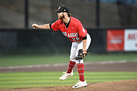 Pitcher Daniel Kight (28) of the North Greenville Crusaders delivers a pitch a game against the Palm Beach Atlantic Sailfish on Monday, February 25, 2019, at Ashmore Park in Tigerville, South Carolina. Palm Beach won, 7-5. (Tom Priddy/Four Seam Images)
