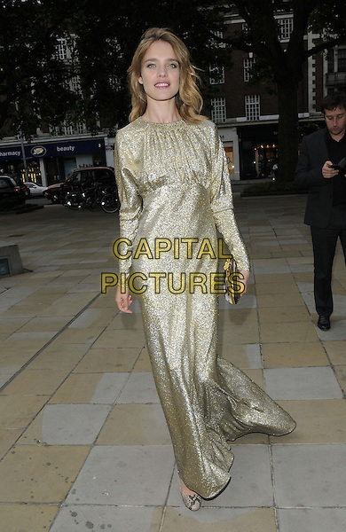 Natalia Vodianova<br /> The Arts for Life pre-auction dinner, Saatchi Gallery, King's Rd., London, England.<br /> June 24th, 2013<br /> full length gold dress sparkly clutch bag<br /> CAP/CAN<br /> &copy;Can Nguyen/Capital Pictures