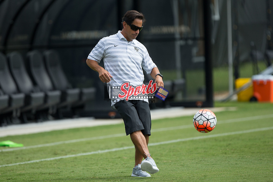 Wake Forest Demon Deacons head coach Tony da Luz helps his team warm-up prior to the match against the Georgia Bulldogs at Spry Soccer Stadium on August 23, 2015 in Winston-Salem, North Carolina.  The Deacons defeated the Bulldogs 4-0.  (Brian Westerholt/Sports On Film)