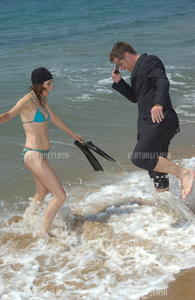 Actress SEAN YOUNG & actor BEN BROWDER on the Carlton Beach in Cannes, France, to promote their new movie A Killer Within. .May 13, 2004