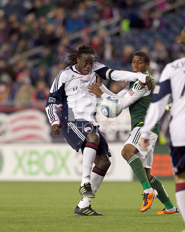 New England Revolution midfielder Shalrie Joseph (21) attempts to control the ball as Portland Timbers midfielder Jeremy Hall (17) pressures. In a Major League Soccer (MLS) match, the New England Revolution tied the Portland Timbers, 1-1, at Gillette Stadium on April 2, 2011.