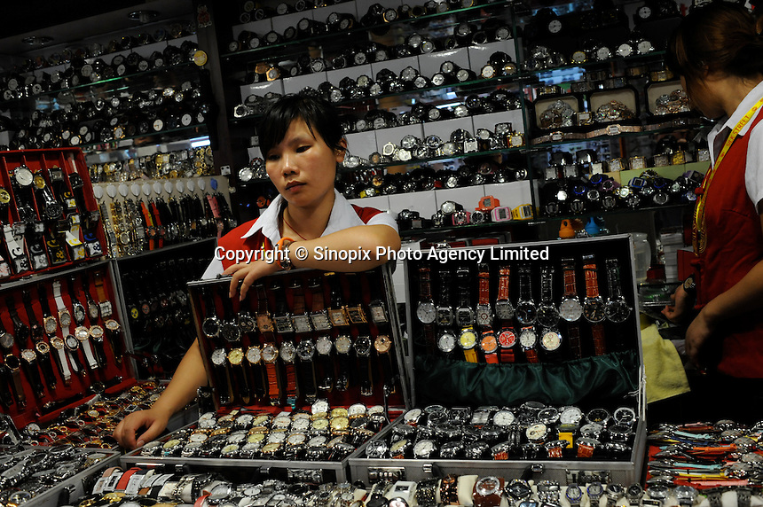 The &quot;Silk Market&quot; in Central Beijing is proving a major tourist attraction to purchase fake designer goods ranging from clothing to watches.  <br /> <br /> Photo by Richard Jones / sinopix