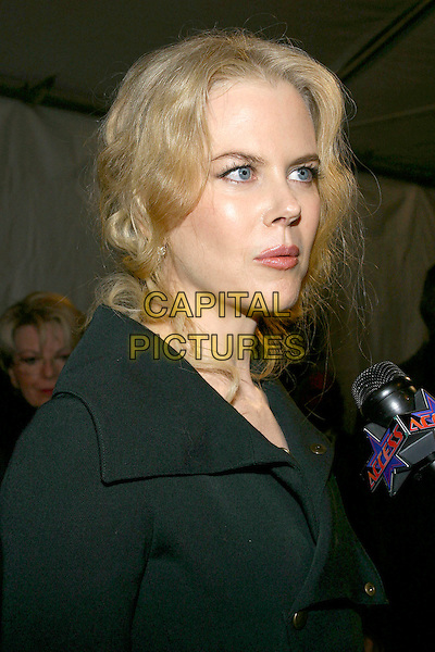 NICOLE KIDMAN.Palm Springs International Film Festival Awards held at the Palm Springs Convention Center, Palm Springs, California, USA, 8th January 2005..portrait headshot funny face.Ref: ADM.www.capitalpictures.com.sales@capitalpictures.com.©Jacqui Wong/AdMedia/Capital Pictures .