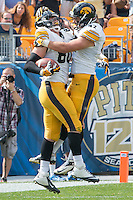 Iowa tight end Henry Krieger Coble (80) celebrates his 13-yard touchdown reception with John Kenny (47). Iowa Hawkeyes defeated the Pitt Panthers 24-20 at Heinz Field, Pittsburgh Pennsylvania on September 20, 2014.