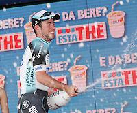 MARK CAVENDISH FESTEGGIA LA VITTORIA DI TAPPA SPRUZZANDO CHAMPAGNE SUI FOTOGRAFIDEL 96° GIRO D'ITALIA.Mark Cavendish of Great Britain and Omega Pharma Team spray champagne to  the  celebrate  the victory of the first stage of 96° Giro d''italia cycling race