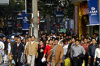 Weekend shopping crowds and advertising on Nanjing Lu.