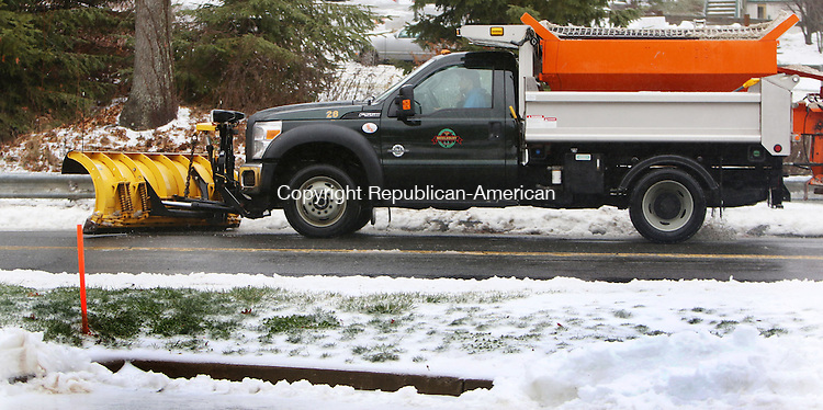 MIDDLEBURY CT. 29 December 2015-122915SV04-A town plowtruck clears snow from Middlebury Road in Middlebury Tuesday.<br /> Steven Valenti Republican-American