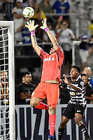 Orlando, FL - Saturday Jan. 21, 2017: Corinthians goalkeeper Cassio Ramos (12) leaps up in front of Corinthians left back Moisés (6) to grab a cross during the second half of the Florida Cup Championship match between São Paulo and Corinthians at Bright House Networks Stadium. The game ended 0-0 in regulation with São Paulo defeating Corinthians 4-3 on penalty kicks