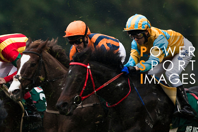 HONG KONG - DECEMBER 12:  Riders compete at the Hong Kong Vase race during the Cathay Pacific International Races at the Sha Tin Racecourse on December 12, 2010 in Hong Kong, Hong Kong. Photo by Victor Fraile / The Power of Sport Images
